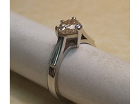 Platinum solitaire ring set with heart shaped diamond