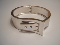 Sterling silver buckle bangle set with three cubic zirconia stones