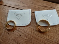 Matching yellow gold wedding rings made by the happy couple on a course