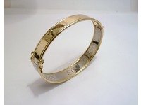 Vintage style white and gold bangle with hand engraving on inside