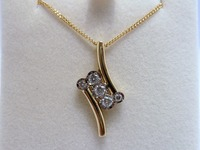 18ct yellow gold cross over pendant set with diamonds
