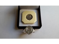 Palladium signet ring seal engraved with crest and motto, showing wax impression