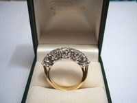 Traditional 18ct yellow and white gold five stone showing gallery setting