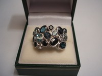 9ct white gold dress ring set with sapphires,blue topaz & aquamarine
