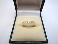 Shaped diamond set 18ct wedding ring
