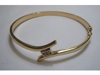 9ct cross over style bangle pave set with 3 diamonds in centre