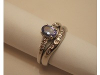 18ct white gold diamond set shaped wedding ring with matching white gold tanzanite and diamond engagement ring