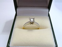 18ct yellow and white gold single stone ring set with round diamond in a sqaure setting