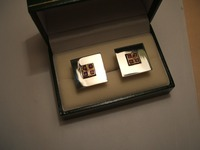 Silver cufflinks set with 4 square rubies in each