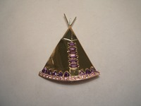 Designed and handmade by us 9ct wigwam brooch set with amethysts and pink sapphires