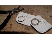 Palladium and 9ct white old wedding rings made by the happy couple on a course