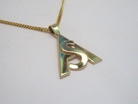 Yellow gold initial pendant