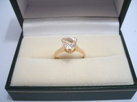 9ct yellow gold ring set with trillion cut white sapphire