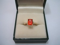 9ct yellow gold single stone ring set with octagonal cut fire opal, angular shoulders