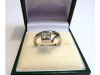 Contemporary style ring set with a single Princess cut diamond