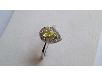 Superb platinum ring set with a centre yellow diamond , and brilliant cut diamonds around